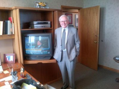 Warren Buffet in His Office, Courtesy Arianna Huffington